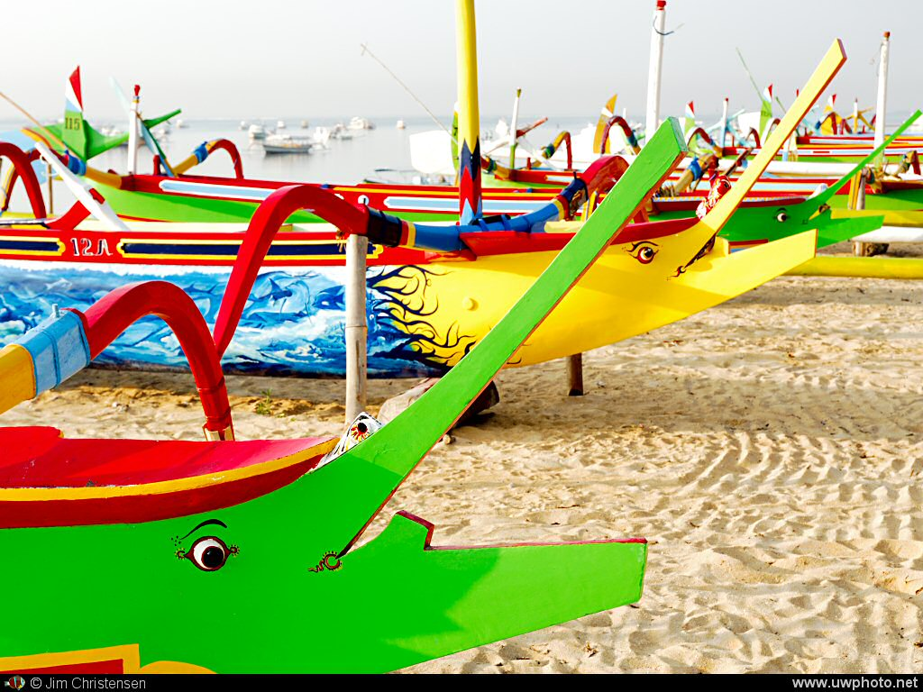 Colorful boats: A row of brightly painted boats along the shore.